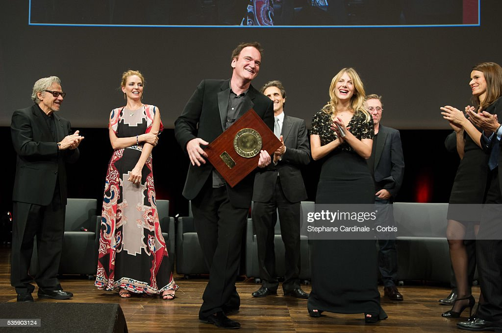 US Director Quentin Tarantino dances with Melanie Laurent next to Harvey Keitel, Uma Thurman, Lawrence Bender and Aurelie Filippetti after receiving the Lumiere Award, during the 5th Lumiere Film Festival, in Lyon.
