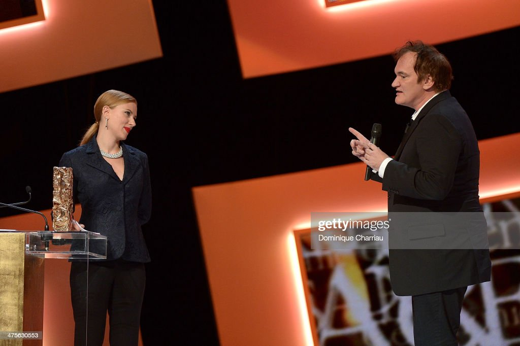 Director Quentin Tarantino hands out the Honorary Cesar to actress Scarlett Johansson on stage during the 39th Cesar Film Awards 2014 at Theatre du Chatelet on February 28, 2014 in Paris, France.
