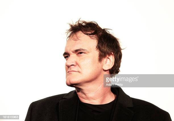 Director Quentin Tarantino poses for photos before the special screening of 'Django Unchained' at Shinjuku Piccadilly on February 13 2013 in Tokyo...