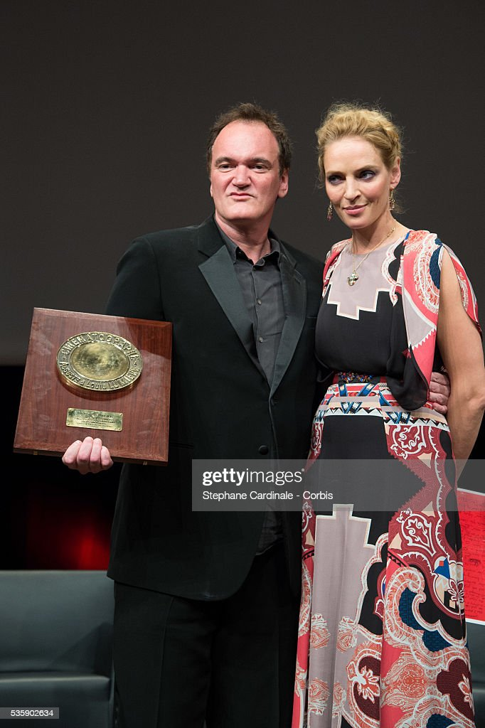 US Director Quentin Tarantino poses next to actress Uma Thurman after receiving the Lumiere Award, during the 5th Lumiere Film Festival, in Lyon.