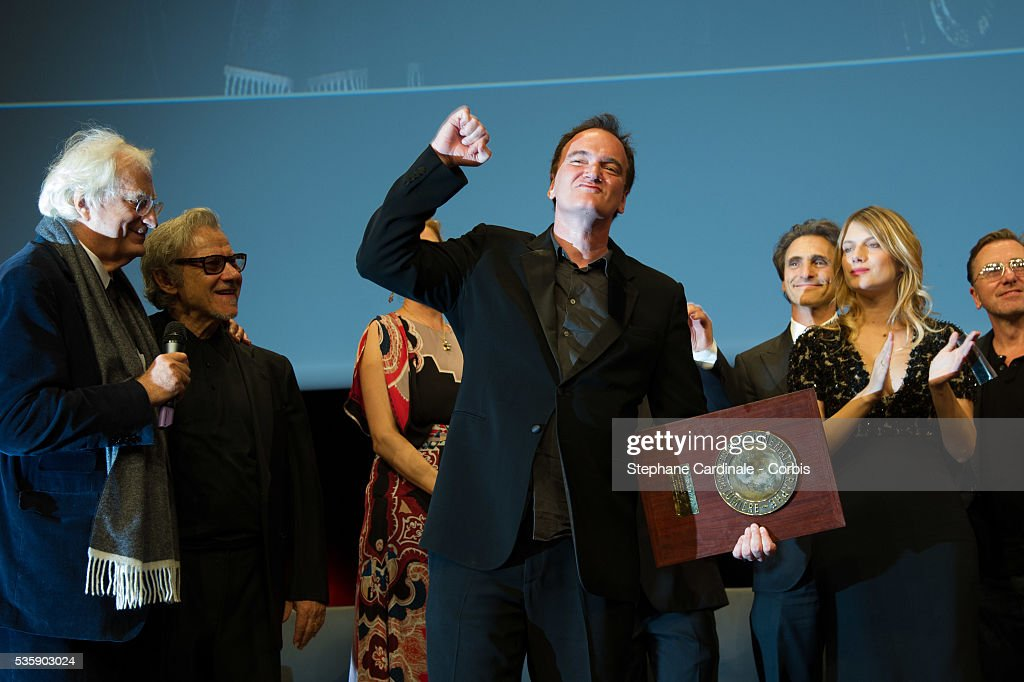 US Director Quentin Tarantino poses next to Bertrand Tavernier, Harvey Keitel and Melanie Laurent after receiving the Lumiere Award, during the 5th Lumiere Film Festival, in Lyon.
