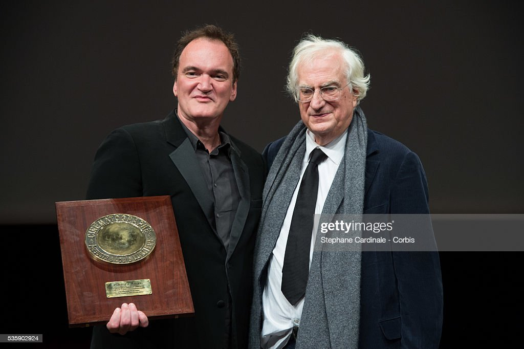 US Director Quentin Tarantino poses next to director Bertrand Tavernier after receiving the Lumiere Award, during the 5th Lumiere Film Festival, in Lyon.