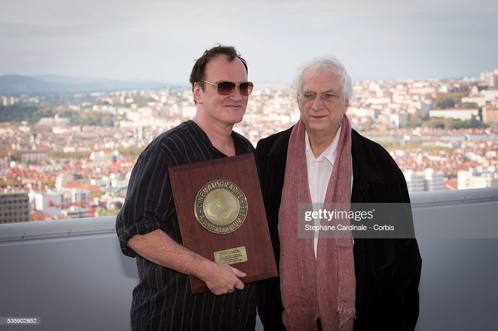 US Director Quentin Tarantino poses with the Lumiere Award next to director Bertrand Tavernier, in front of a general view of the City of Lyon, during the 5th Lumiere Film Festival, in Lyon.