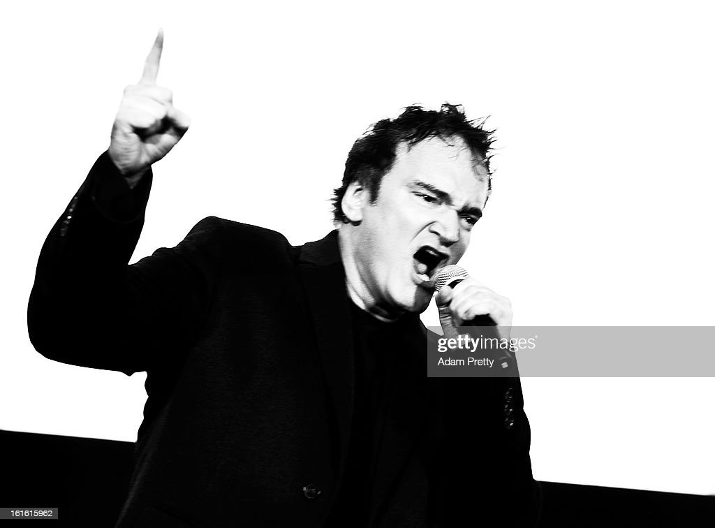 Director Quentin Tarantino revs up the crowd before the special screening of 'Django Unchained' at Shinjuku Piccadilly on February 13, 2013 in Tokyo, Japan. The film will open on March 1 in Japan.