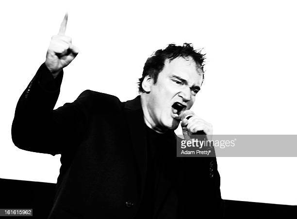 Director Quentin Tarantino revs up the crowd before the special screening of 'Django Unchained' at Shinjuku Piccadilly on February 13 2013 in Tokyo...