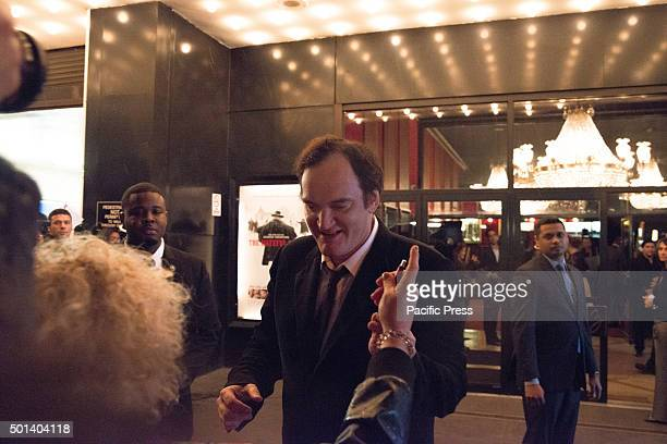 Director Quentin Tarantino signs autographs for fans gathered around the theater entrance before the premiere of 'Hateful Eight' At the premiere of...
