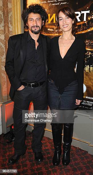 Director Radu Mihaileanu and French actress Mioumiou pose as they attend 'Le Concert' 2 Millions Viewers Celebration Party at Ritz Club on February 5...