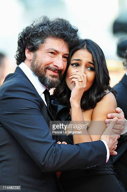 Director Radu Mihaileanu and Hafsia Herzi attends the 'La Source Des Femmes' Premiere at Palais des Festivals during the 64th Annual Cannes Film...