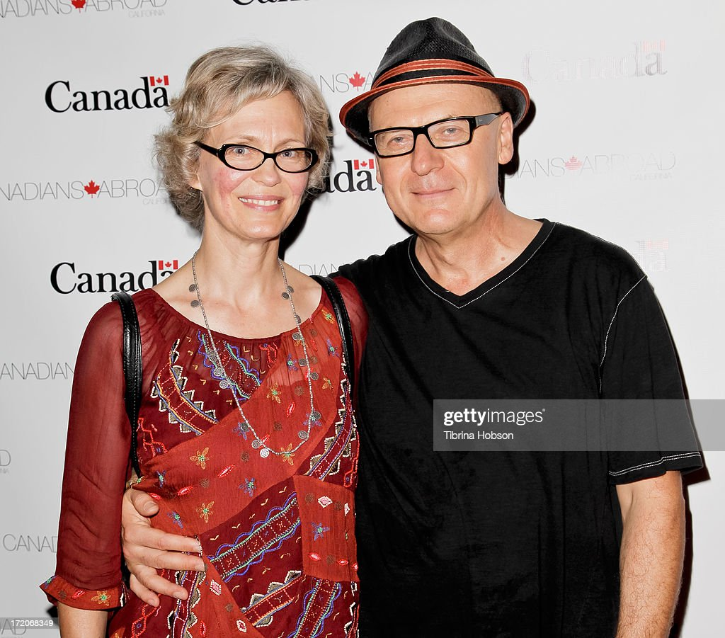 Director Rafal Zielinski (R) and his wife attend the 2013 Canada Day in LA party at Wokano restaurant on June 30, 2013 in Santa Monica, California.