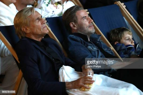 Director Randall Kleiser and actor John Travolta attend the 'Grease' 40th Anniversary Screening during the 71st annual Cannes Film Festival at on May...