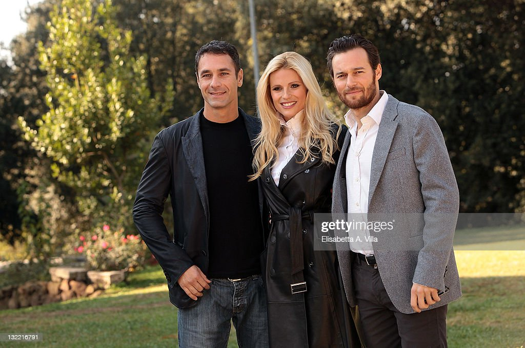 Director Raoul Bova, actress Michelle Hunziker and actor Giorgio Marchesi attend 'Amore Nero' photocall at Villa Borghese on November 11, 2011 in Rome, Italy.