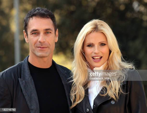 Director Raoul Bova and actress Michelle Hunziker attend 'Amore Nero' photocall at Villa Borghese on November 11 2011 in Rome Italy