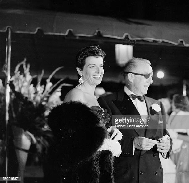 Director Raoul Walsh with Jane Russell attend the movie premiere of The Tall Men in Los AngelesCA