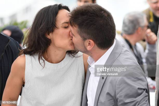 Director Raul de la Fuente and producer Amaia Remirez kiss as they attend the photocall for the 'Another Day Of Life' during the 71st annual Cannes...