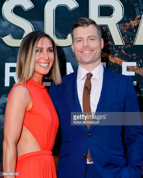 Director Rawson Marshall Thurber and a guest attend the premiere of 'Skyscraper' on July 10 2018 in New York City
