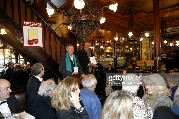Director Regis Wargnier and President of the Prize Jury Joel Schmidt speak during the 83rd Prix Cazes de la Brasserie Lipp Literary Prize at...
