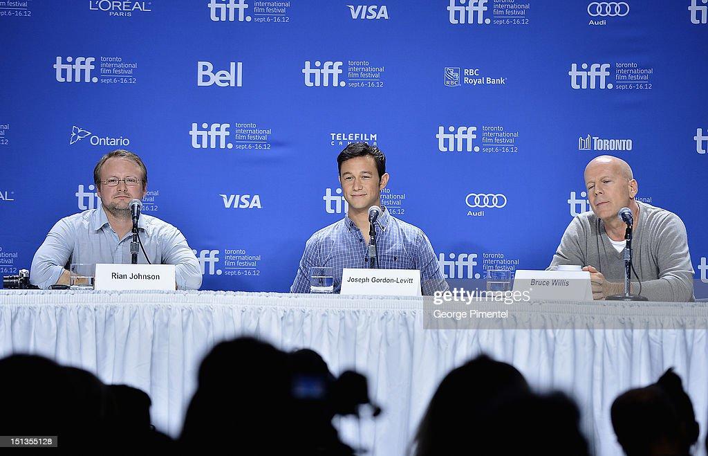 Director Rian Johnson, actor Joseph Gordon-Levitt and actor Bruce Willis attend the 'Looper' press conference during the 2012 Toronto International Film Festival at TIFF Bell Lightbox on September 6, 2012 in Toronto, Canada.