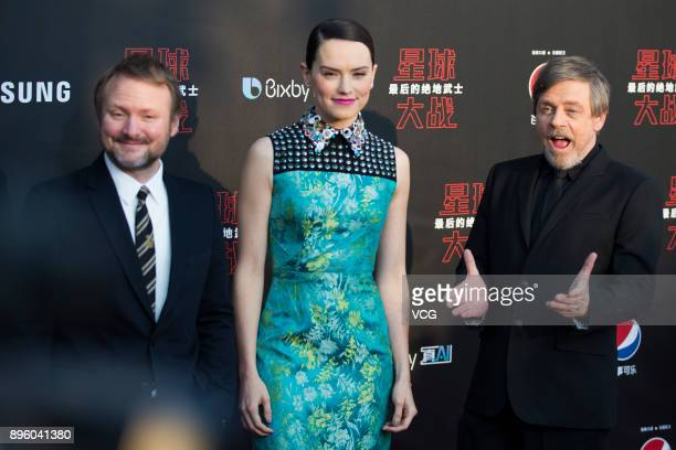 Director Rian Johnson actress Daisy Ridley and actor Mark Hamill arrive at the premiere of film 'Star Wars The Last Jedi' at Shanghai Disney Resort...