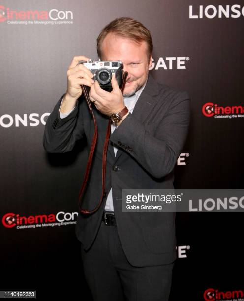 Director Rian Johnson takes a photo during the Lionsgate presentation during CinemaCon at The Colosseum at Caesars Palace on April 04 2019 in Las...