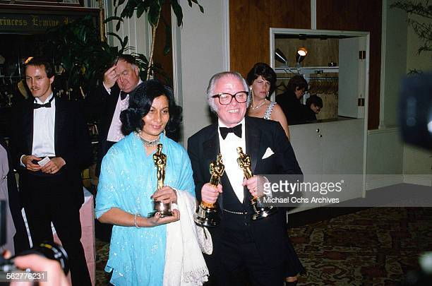 Director Richard Attenborough winner of Best Director poses with Bhanu Athaiya winner of Best Costume Design backstage during the 55th Academy Awards...