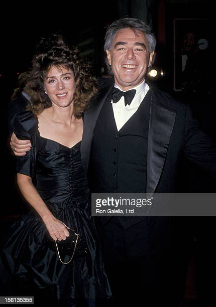 Director Richard Donner and wife Lauren Shuler attend the premiere of 'Scrooged' on November 17 1988 at Mann Chinese Theater in Hollywood California