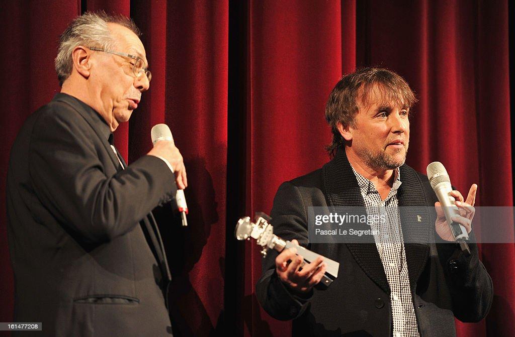 Director Richard Linklater is awarded a Berlinale Kamera by festival director Berlin Film Festival Director Dieter Kosslick after the 'Before Midnight' Premiere during the 63rd Berlinale International Film Festival at the Berlinale Palast on February 11, 2013 in Berlin, Germany.
