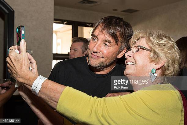Director Richard Linklater poses for a photo with guests during the premiere of 'Boyhood' at Marchesa Hall & Theater on July 13, 2014 in Austin,...