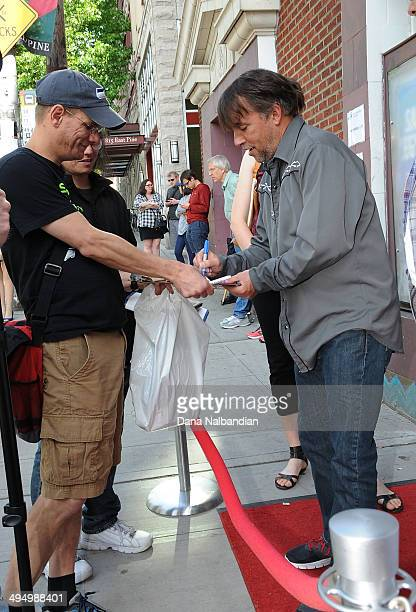 """Director Richard Linklater signs an autograph for a fan before Seattle International Film Festival showing of """"Boyhood"""" at the Egyptian Theater on..."""