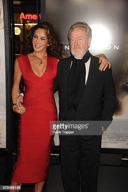"""Director Ridley Scott and Giannina Facio arrive at the AFI FEST World Premiere of """"Concussion"""" held at the TCL Chinese Theatre in Hollywood."""