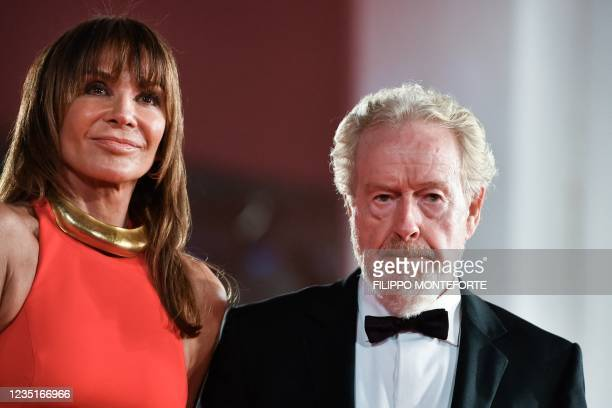 """Director Ridley Scott and his wife Costa Rican actress and producer Giannina Facio arrive for the screening of the film """"The Last Duel"""" presented out..."""