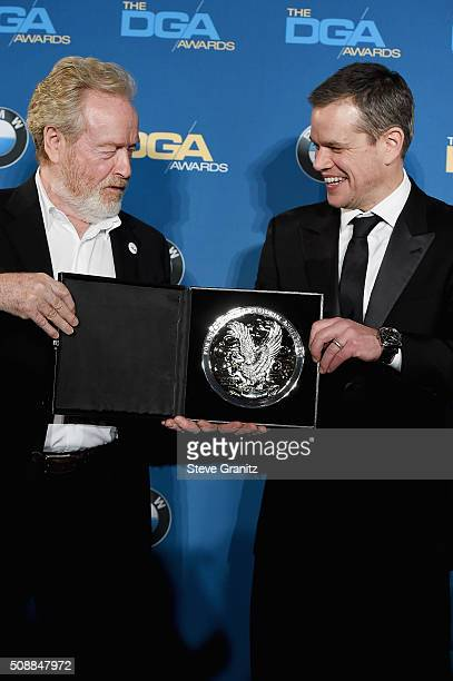 """Director Ridley Scott recipient of the Feature Film Nomination Plaque for """"The Martian"""" and actor Matt Damon pose in the press room during the 68th..."""