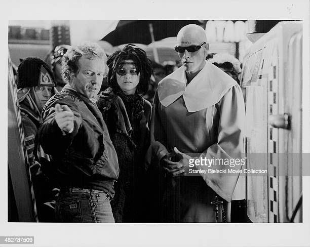Director Ridley Scott with supporting actors in costume on the set of movie 'Blade Runner' 1982