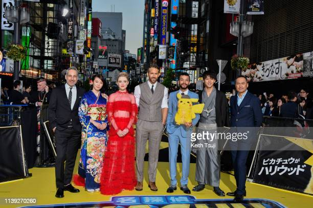 Director Rob Letterman actress Marie Iitoyo Kathryn Newton actor Ryan Reynolds Justice Smith Ryoma Takeuchi and Ken Watanabe attend the world...