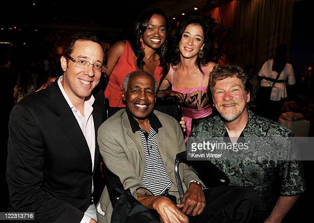 Director Rob Minkoff actors Robert Guillaume Niketa Calame Moira Kelly and director Roger Allers pose at the after party for the premiere of Walt...
