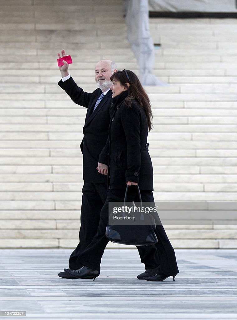 Director Rob Reiner, left, waves while walking into the U.S. Supreme Court in Washington, D.C., U.S., on Tuesday, March 26, 2013. The Supreme Court takes up what is probably its biggest civil-rights dispute in decades this week when it hears arguments that could lead to the legalization of same-sex marriage nationwide. Photographer: Andrew Harrer/Bloomberg via Getty Images