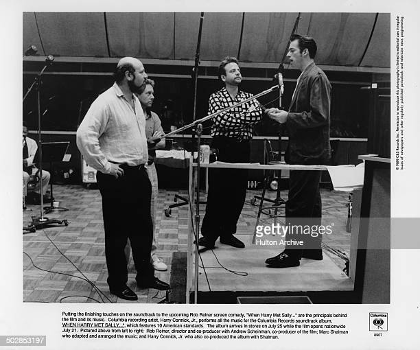 Director Rob Reiner watches the finishing touches as Harry Connick Jr sings for the sound track to the movie When Harry Met Sally circa 1989