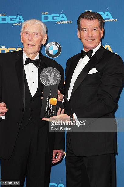 Director Robert Butler winner of the Lifetime Achievement in Television Direction Award poses with actor Pierce Brosnan in the press room at the 67th...