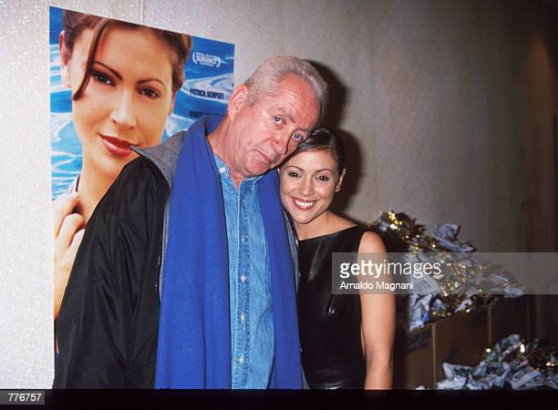 Director Robert Downey Sr stands beside actress Alyssa Milano at the premiere of Hugo Pool December 3 1997 in New York City The movie is about a Los...