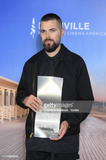 Director Robert Eggers poses with the Jury Prize for ' The Lighthouse' during the Jury Award Winners photocall during the 45th Deauville American...