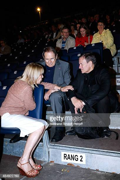 Director Robert Hossein standing between his wife Candice Patou and actor Francis Huster attend the 'Claude Lelouch en Musique Held at the Invalides...