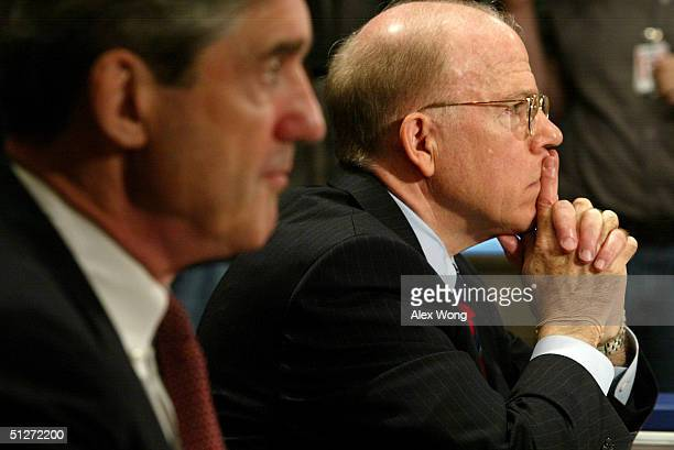 Director Robert Mueller and Acting CIA Director John McLaughlin attend a hearing before the Senate Governmental Affairs Committee on Capitol Hill...