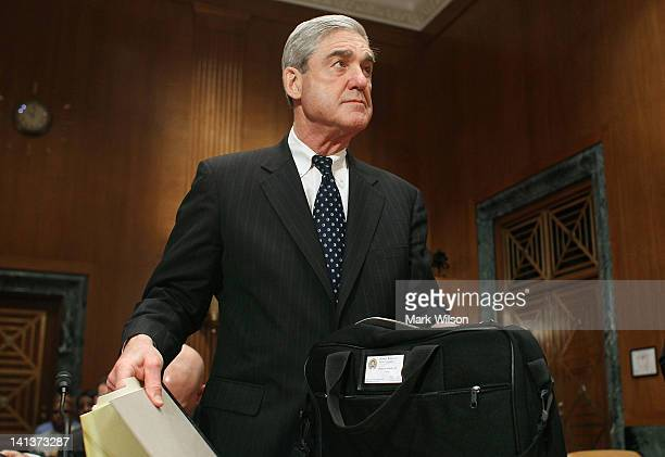 Director Robert Mueller arrives at a Senate Appropriations Committee hearing on Capitol Hill on March 15 2012 in Washington DC The committee is...