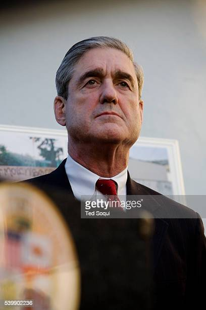 FBI Director Robert Mueller attends a press conference at the Del Amo Market inside the 'forbidden line' area to respond to a racially motivated...