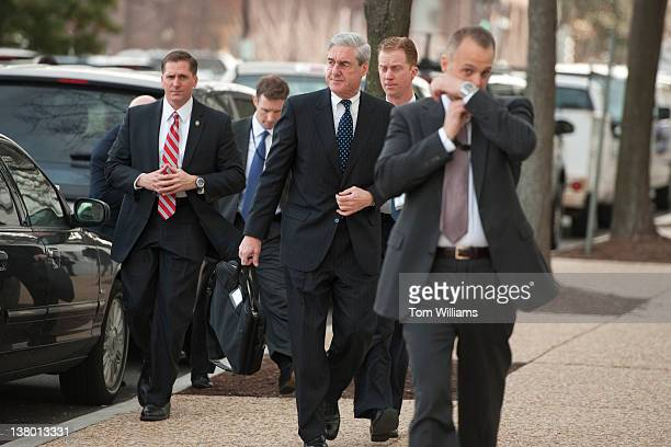 Director Robert Mueller center arrives on Capitol Hill to testify before a Senate Intelligence Committee hearing in Hart Building entitled 'World...