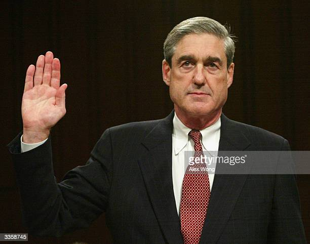 Director Robert Mueller is sworn in April 14 2004 during the second day of the 10th public hearing on the performance of law enforcement and the...