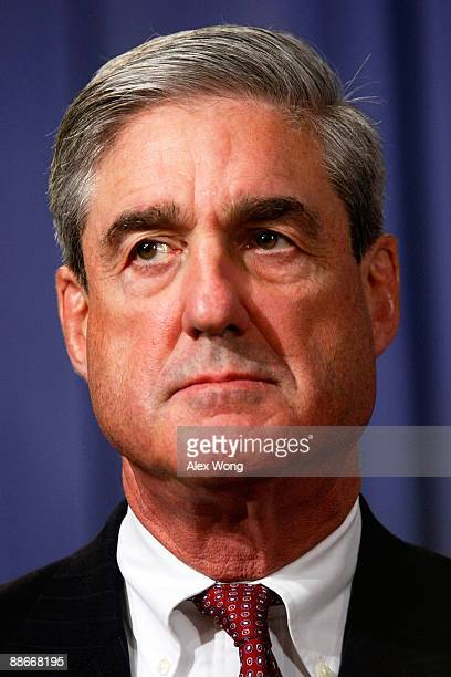 Director Robert Mueller listens during a news conference at the Justice Department June 24 2009 in Washington DC The Justice Department has indicted...