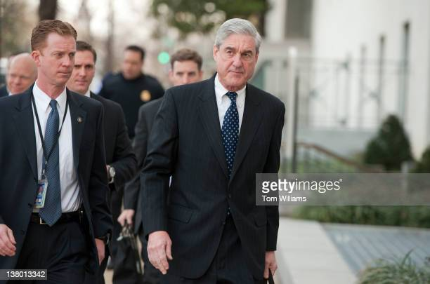 Director Robert Mueller right arrives on Capitol Hill to testify before a Senate Intelligence Committee hearing in Hart Building entitled 'World Wide...