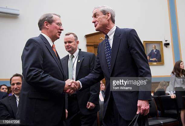 Director Robert Mueller right talks with Chairman Bob Goodlatte RVa before a House Judiciary Committee hearing in Rayburn on oversight of the FBI
