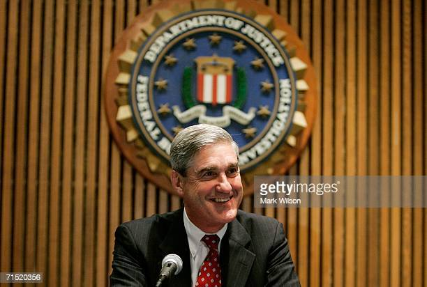 Director Robert Mueller smiles before the start of a briefing with reporters at the FBI Headquarters July 26, 2006 in Washington DC. Mueller...