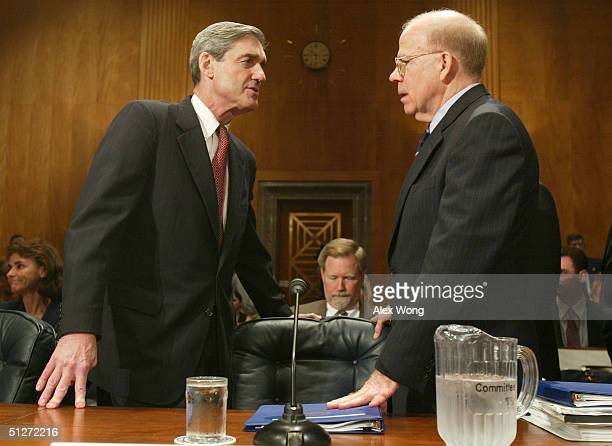 Director Robert Mueller talks to Acting CIA Director John McLaughlin prior to a hearing before the Senate Governmental Affairs Committee on Capitol...